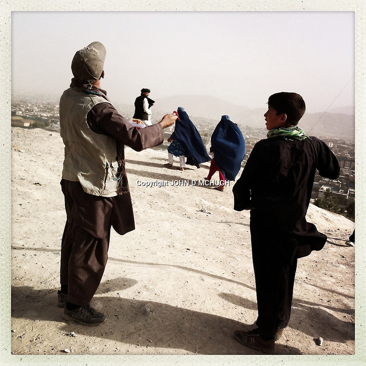 ** TO GO WITH AFGHANISTAN STORY FOR PETER MURTAGH - NO ARCHIVE, NO RESALE ** People fly kites at King Zahir Shah's Tomb in Kabul, 24 August 2012. (John D McHugh)