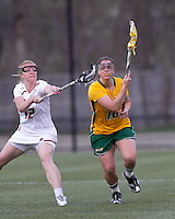 University of Vermont defender Taylor Pedersen (10) brings the ball forward as Boston College attacker Moira Barry (12) pressures. Boston College defeated University of Vermont, 15-9, at Newton Campus Field, April 4, 2012.