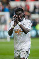 SWANSEA, WALES - APRIL 04: Bafetimbi Gomis of Swansea City  applauds fans as he leaves the field after the final whistle during the Premier League match between Swansea City and Hull City at Liberty Stadium on April 04, 2015 in Swansea, Wales.  (photo by Athena Pictures)