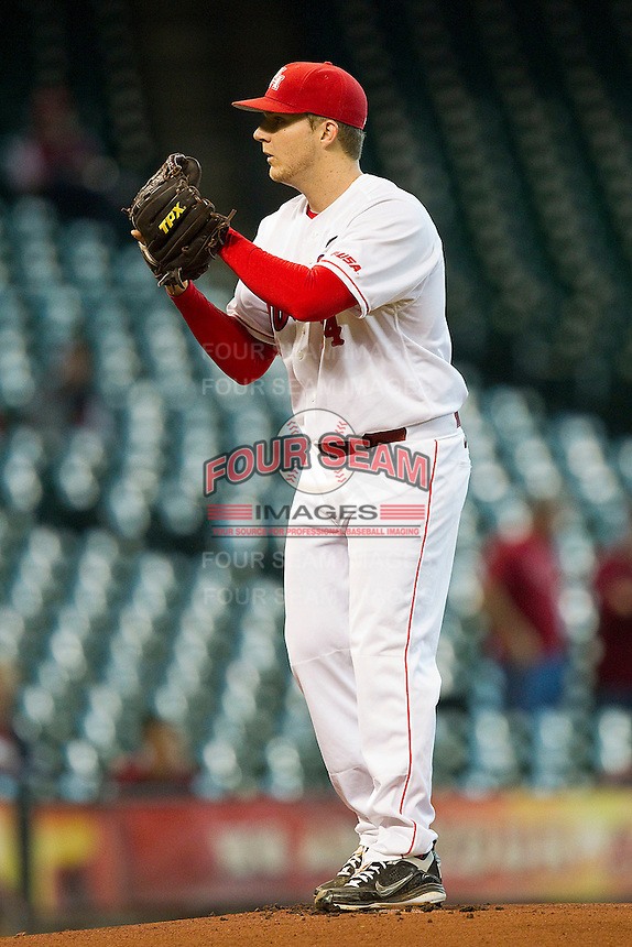 Houston Cougars starting pitcher Jordan Lewis #14 looks to his catcher for the sign against the Arkansas Razorbacks at Minute Maid Park on March 3, 2012 in Houston, Texas.  The Cougars defeated the Razorbacks 4-1.  (Brian Westerholt/Four Seam Images)