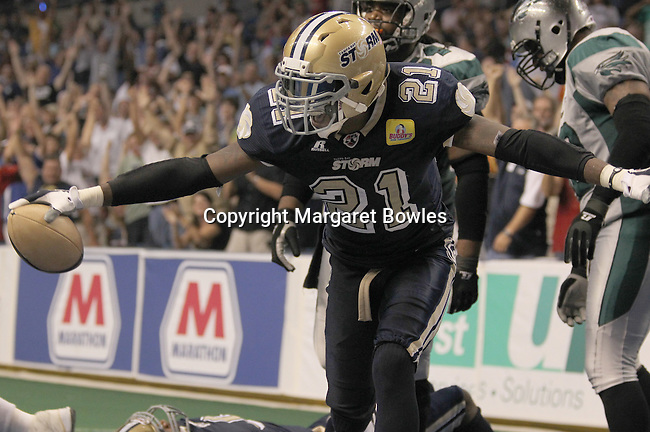 25 June 2010: Tampa defensive back Michael Hawthorne picks up a loose ball and scores.  The Tampa Bay Storm defeated the Bossier-Shreveport Battle Wings 78-39 at the St. Pete Forum in Tampa, Florida