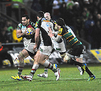 Northampton, England. Maurie Fa'asavalu of Harlequins charges forward during the Aviva Premiership match between Northampton Saints and Harlequins at Franklin's Gardens on December 22. 2012 in Northampton, England.