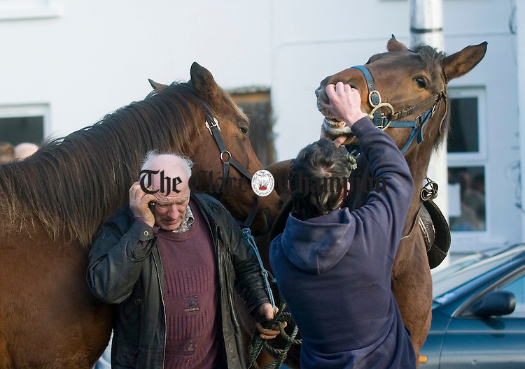 Noel Griffin takes a call on his mobile at Ennistymon Horse Fair. Photograph by John Kelly.