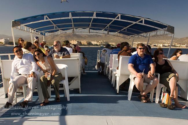 Tourists enjoying a sunset dinner cruise, Cabo San Lucas, Baja California, Mexico