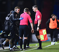 Assistant referee Robert Atkin, pulls up injured and receives treatment from Lincoln City's head of sports science and medicine Mike Hine<br /> <br /> Photographer Andrew Vaughan/CameraSport<br /> <br /> The EFL Sky Bet League Two - Oldham Athletic v Lincoln City - Tuesday 27th November 2018 - Boundary Park - Oldham<br /> <br /> World Copyright © 2018 CameraSport. All rights reserved. 43 Linden Ave. Countesthorpe. Leicester. England. LE8 5PG - Tel: +44 (0) 116 277 4147 - admin@camerasport.com - www.camerasport.com