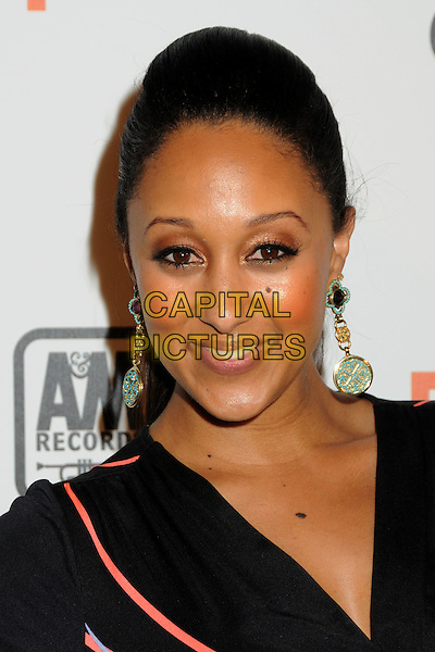 "TAMERA MOWRY .Interscope Geffen A&M Records 4th Annual ""Creme of the Crop"" Post BET Awards 2010 Celebration held at Mr. Chow Restaurant,  Beverly Hills, California, USA, 27th June 2010..portrait headshot earrings smiling dangly pink green black .CAP/ADM/BP.©Byron Purvis/AdMedia/Capital Pictures."
