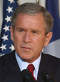 United States President George W. Bush makes remarks to the press after meeting President JacquesChirac of France in the Oval Office of the White House in Washington, DC on November 6, 2001.  The Presidents continued their meetings over lunch in the White House Residence.<br /> Credit: Ron Sachs / CNP