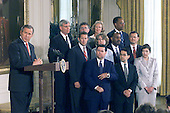 United States President George W. Bush with 11 of his first nominees for Federal judiciary nominations in an event in the East Room of the White House, May 9, 2001.  The judges, left to right, Front row, Judge Dennis Shedd, Migues Estrada and Judge Priscilla Owens; Second row, Jeffrey Sutton, Judge Edith Brown Clement, Judge Roger Gregory and John Roberts; Back row, Judge Terrence Boyle, Michael McConnell, Judge Deborah Cook and Judge Barrington Parker.<br /> Credit: CNP