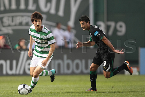 21 JUL 2010:  Celtic's Ki Sung Yueng (18) chased by Sporting Lisbon's Carlos Saleiro (9). Celtic and Sporting Clube de Portugal were scoreless at halftime in an international friendly match, part of the Fenway Football Challenge, at Fenway Park in Boston, Massachusetts on July 21, 2010.