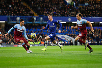30th November 2019; Stamford Bridge, London, England; English Premier League Football, Chelsea versus West Ham United; Mason Mount of Chelsea being marked by Mark Noble and Fabian Balbuena of West Ham United - Strictly Editorial Use Only. No use with unauthorized audio, video, data, fixture lists, club/league logos or 'live' services. Online in-match use limited to 120 images, no video emulation. No use in betting, games or single club/league/player publications