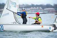 Crew Jennifer Ryan, '19, and Skipper Brian Baker,'18, work the sail as Salve Regina practices in the Newpor Harbor.