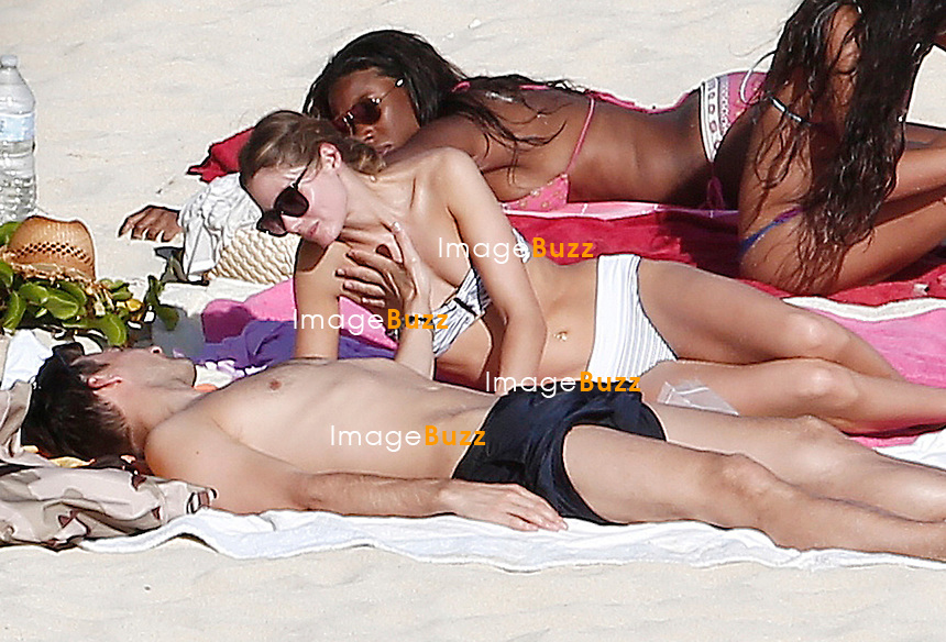 Olivia Palermo shows off her amazing bikini body while spending a romantic day at the beach with her longtime boyfriend Johannes Huebl.<br /> Saint Barths, December 29, 2013.