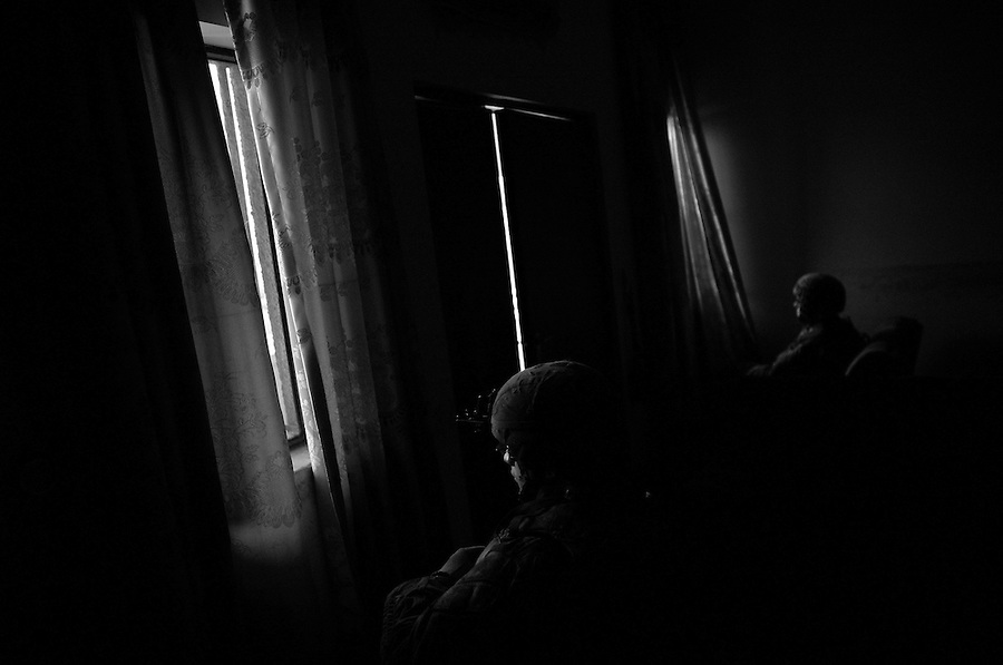 Soldiers from Charlie Co. 1-26 Infantry 1st Infantry Division stand guard while a meeting is held at the District Council building in the Adhamiyah section of Baghdad on Sunday April 29, 2007.