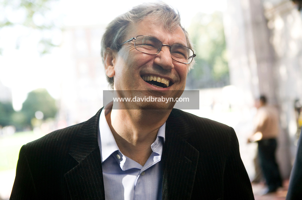 12 October 2006 - New York City, NY - Turkish novelist Orhan Pamuk laughs as he leaves a press conference at Columbia University in New York City, USA, 12 October 2006, after winning the Nobel literature prize for his works dealing with the symbols of clashing cultures.