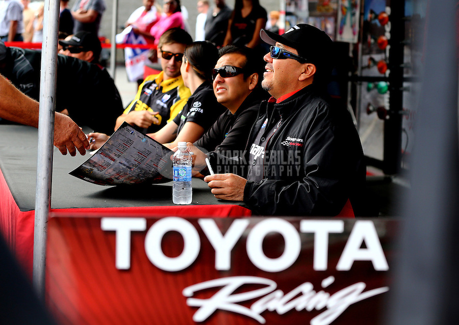 Sep 14, 2013; Charlotte, NC, USA; NHRA funny car driver Cruz Pedregon (near) and brother Tony Pedregon during qualifying for the Carolina Nationals at zMax Dragway. Mandatory Credit: Mark J. Rebilas-