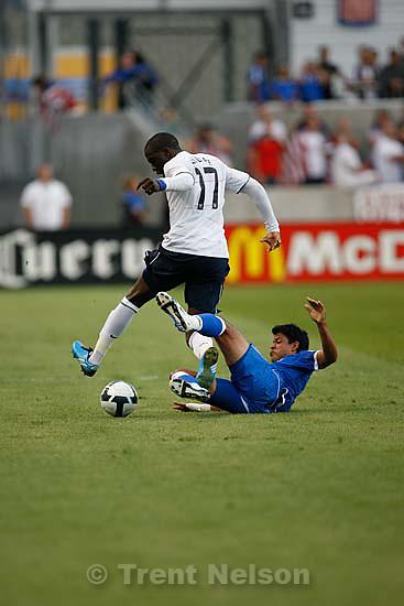 Sandy - USA forward Jozy Altidore dribbles past El Salvador defender Manuel Salazar (12). USA vs. El Salvadar FIFA World Cup Qualifier Soccer Saturday, September 5 2009 at Rio Tinto Stadium. .