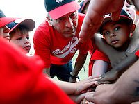 "Billy Martin leads his tee ball team in a cheer of ""hard work makes champions,"" before a game at the old McCants field in Anderson. Martin's team, the Bulldogs, begin and end every game with the cheer."