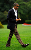 Washington, DC - September 12, 2009 -- United States President Barack Obama walks across the South Lawn of the White House toward the Oval Office in Washington on September 12, 2009. President Obama traveled to Minneapolis, Minnesota to speak at a rally on health insurance reform.  .Credit: Alexis C. Glenn / Pool via CNP