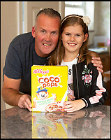 BNPS.co.uk (01202 558833)<br /> Pic : RogerArbon/BNPS<br /> <br /> Hannah-Marie Clayton with her dad Jim at their home in Bournemouth, Dorset.<br /> <br /> A schoolgirl has forced Kelloggs to change its 'sexist' wording on packets of Coco Pops after writing to the cereal giant to complain.<br /> <br /> Hannah-Marie Clayton, 10, objected to the slogan 'Loved by kids, approved by mums' on the boxes of the chocolate cereal.<br /> <br /> So she fired off a letter to Kellogs saying she found the phrase 'sexist' and pointed out her dad James often makes her breakfast as mum, Anne-Marie, sometimes works away.<br /> <br /> Kelloggs has since replied to confirm they will be altering the wording on the boxes.