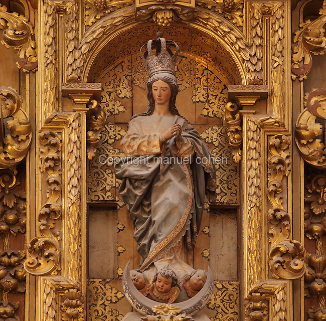 The Virgin of the Immaculate Conception by Jose Risueno, restored by Diego da Mora, from the Triunfo de Santiago altarpiece, made 1707-8 by Francisco Hurtado Izquierdo, 1669-1725, in Granada Cathedral, or the Cathedral of the Incarnation, built 16th and 17th centuries in Renaissance style with Baroque elements, Granada, Andalusia, Southern Spain. Several architects worked on the cathedral, which, unusually, has 5 naves and a circular capilla mayor instead of an apse. Granada was listed as a UNESCO World Heritage Site in 1984. Picture by Manuel Cohen