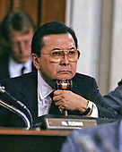 United States Senator Daniel K. Inouye (Democrat of Hawaii), Chairman of the Senate Select Committee on Secret Military Assistance to Iran and the Nicaraguan Opposition, leans on his gavel as he listens to testimony during a Summer, 1987 hearing.  Senator Inouye passed away due to respiratory complications at Walter Reed National Military Medical Center in Bethesda on Monday, December 17, 2012. He was 88..Credit: Ron Sachs / CNP