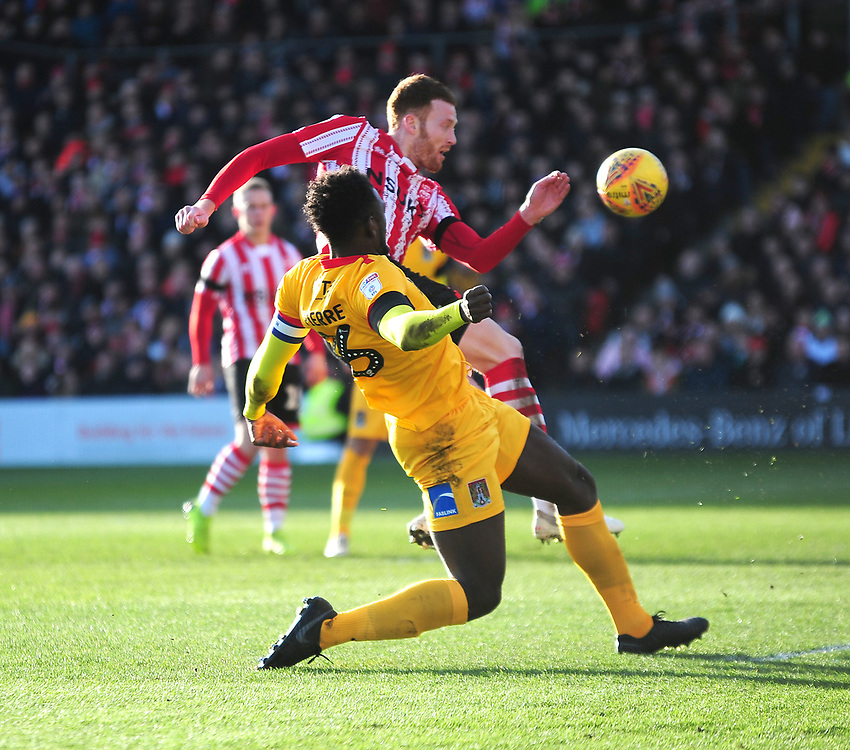 Lincoln City's Cian Bolger gets a shot on target under pressure from Northampton Town's Aaron Pierre<br /> <br /> Photographer Andrew Vaughan/CameraSport<br /> <br /> The EFL Sky Bet League Two - Lincoln City v Northampton Town - Saturday 9th February 2019 - Sincil Bank - Lincoln<br /> <br /> World Copyright © 2019 CameraSport. All rights reserved. 43 Linden Ave. Countesthorpe. Leicester. England. LE8 5PG - Tel: +44 (0) 116 277 4147 - admin@camerasport.com - www.camerasport.com