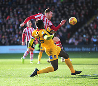 Lincoln City's Cian Bolger gets a shot on target under pressure from Northampton Town's Aaron Pierre<br /> <br /> Photographer Andrew Vaughan/CameraSport<br /> <br /> The EFL Sky Bet League Two - Lincoln City v Northampton Town - Saturday 9th February 2019 - Sincil Bank - Lincoln<br /> <br /> World Copyright &copy; 2019 CameraSport. All rights reserved. 43 Linden Ave. Countesthorpe. Leicester. England. LE8 5PG - Tel: +44 (0) 116 277 4147 - admin@camerasport.com - www.camerasport.com