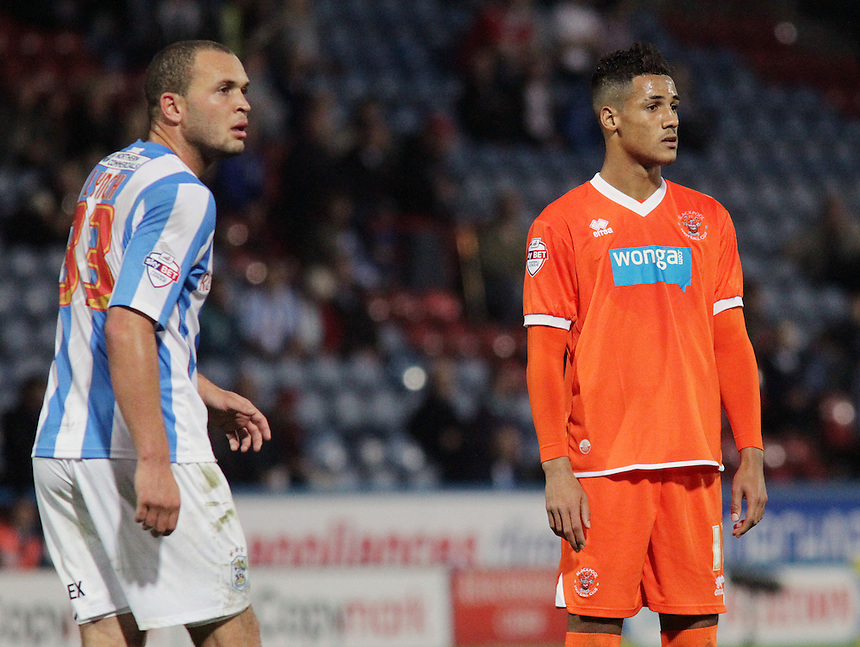 Huddersfield Town's Joel Lynch and Blackpool's Thomas Ince<br /> <br /> Photo by Rich Linley/CameraSport<br /> <br /> Football - The Football League Sky Bet Championship - Huddersfield Town v Blackpool - Friday 27th September 2013 - The John Smith's Stadium - Huddersfield<br /> <br /> &copy; CameraSport - 43 Linden Ave. Countesthorpe. Leicester. England. LE8 5PG - Tel: +44 (0) 116 277 4147 - admin@camerasport.com - www.camerasport.com