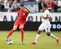 KANSAS CITY, KS - JUNE 26: Matt Miazga #19 dribbles the ball as Gabriel Torres #9 looks on during a game between United States and Panama at Children's Mercy Park on June 26, 2019 in Kansas City, Kansas.