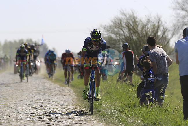 The peloton on pave sector 17 Hornaing a Windignies during the 115th edition of the Paris-Roubaix 2017 race running 257km Compiegne to Roubaix, France. 9th April 2017.<br /> Picture: Eoin Clarke | Cyclefile<br /> <br /> <br /> All photos usage must carry mandatory copyright credit (&copy; Cyclefile | Eoin Clarke)