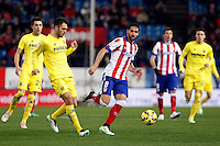 Raul Garcia of Atletico de Madrid and Bruno asn Victor Ruiz of Villarreal during La Liga match between Atletico de Madrid and Villarreal at Vicente Calderon stadium in Madrid, Spain. December 14, 2014. (ALTERPHOTOS/Caro Marin) /NortePhoto