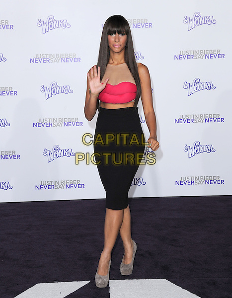 "LEONA LEWIS .attending the Paramount Pictures' L.A. Premiere of ""Justin Bieber: Never Say Never"" held at The Nokia Theater Live in Los Angeles, California, USA,.February 8th 2011..full length red pink lips dress cut out midriff mesh flesh beige sleeveless fringe black pencil skirt mouth platform grey gray shoes suede hand waving .CAP/RKE/DVS.©DVS/RockinExposures/Capital Pictures."