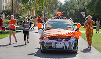 Homecoming gets kicked off with the traditional car parade through the quad, Thursday, Oct. 23, 2014. (Photo by Marc Campos, College Photographer)