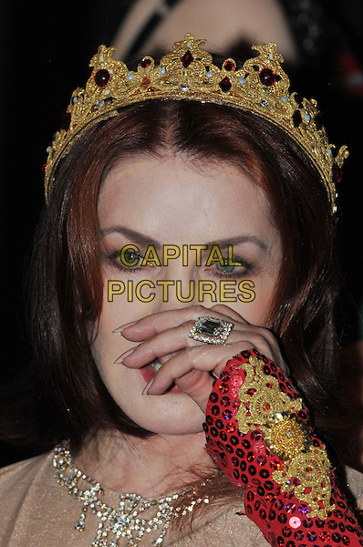 Priscilla Presley.Press launch to star in New Wimbledon Theatre's annual pantomime offering 'Snow White and the Seven Dwarfs' at The Savoy, Strand, London, England..September 26th, 2012.panto costume headshot portrait gold red crown sequins sequined  hand ring rubbing nose.CAP/BF.©Bob Fidgeon/Capital Pictures.