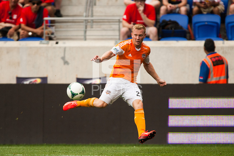 Andrew Driver (20) of the Houston Dynamo. The New York Red Bulls defeated the Houston Dynamo 2-0 during a Major League Soccer (MLS) match at Red Bull Arena in Harrison, NJ, on June 30, 2013.