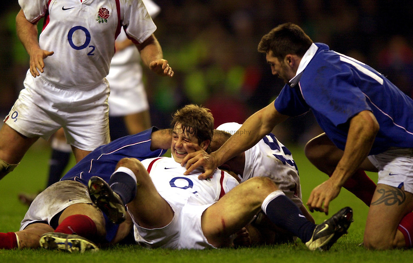 Photo. Richard Lane. .England v France at Twickenham. RBS Six Nations Championship. 15/02/2003.Andy Gomarsall gets one in the face.
