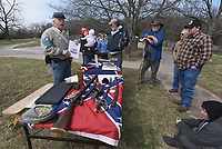 NWA Democrat-Gazette/FLIP PUTTHOFF<br /> BATTLE OF PEA RIDGE REMEMBERED<br /> Damon Hudson (left) with the Sons of Confederate Veterans talks about Confederate battle flags on Saturday March 17 2018 at Pea Ridge National Military Park east of Pea Ridge. Education activities at the Civil War battlefield observed the 136th anniversary of The Battle of Pea Ridge that raged March 7-8, 1862. The event included cannon firing, Civil War campsites, speakers and a concert by the Northwest Arkansas Heritage Brass Ensemble.