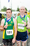Sean O'Sullivan third and Donal O'Callaghan who won the 10k  at the end of the Killarney Run half marathon in the Gleneagle Hotel on Saturday