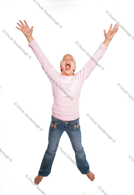 Stock Photo of A teen girl with her hands and arms up and yelling out loud!