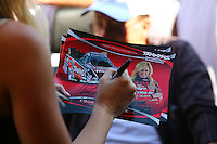 Aug. 3, 2014; Kent, WA, USA; Detailed view as NHRA funny car driver Courtney Force signs autographs during the Northwest Nationals at Pacific Raceways. Mandatory Credit: Mark J. Rebilas-