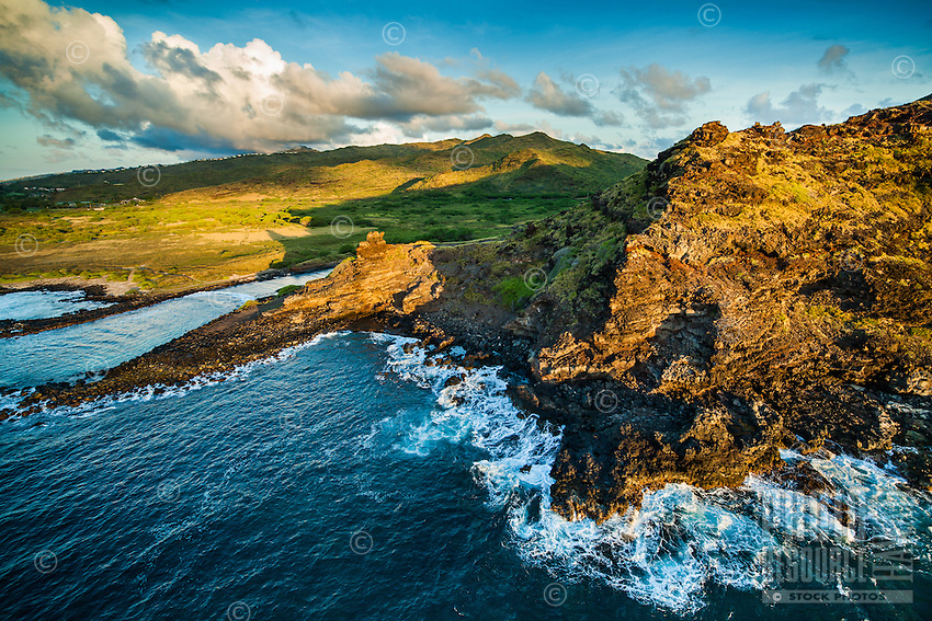 An aerial view of a semi-distant and sunlit Pele's Chair overlooking Alan Davis Beach along the Ka'iwi coastline of Hawai'i Kai, East O'ahu.