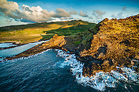 An aerial view of a semi-distant and sunlit Pele's Chair overlooking Alan Davis Beach along the Ka'iwi coastline of Hawai'i Kai, East O'ahu.