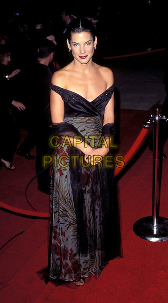 SANDRA BULLOCK.Ref: 8089.black dress, off the shoulder, floral print, red carpet, full length, full-length.www.capitalpictures.com.sales@capitalpictures.com.© Capital Pictures