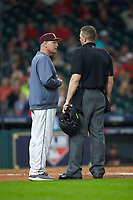 Mississippi State Bulldogs interim head coach Gary Henderson discusses a call with home plate umpire Matt McKendry during the game against the Houston Cougars in game six of the 2018 Shriners Hospitals for Children College Classic at Minute Maid Park on March 3, 2018 in Houston, Texas. The Bulldogs defeated the Cougars 3-2 in 12 innings. (Brian Westerholt/Four Seam Images)