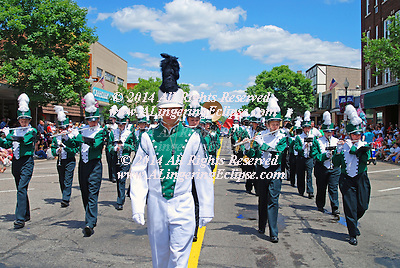 "Independence Day Parade, July 4, 2008 in Rural Wisconsin: High School Band  Marches in Perfect Formation Down Main Street...By the 1870s, the Fourth of July was the most important secular holiday on the calendar. Congress passed a law making Independence Day a federal holiday on June 28, 1870. Even far-flung communities on the western frontier managed to congregate on Independence Day. In an American Life Histories: Manuscripts from the Federal Writers' Project, 1936-1940 interview, Miss Nettie Spencer remembered the Fourth as the ""big event of the year. Everyone in the countryside got together on that day for the only time in the year."" She continued, ....""There would be floats in the morning and the one that got the [girls?] eye was the Goddess of Liberty. She was supposed to be the most wholesome and prettiest girl in the countryside ? if she wasn't she had friends who thought she was. But the rest of us weren't always in agreement on that?Following the float would be the Oregon Agricultural College cadets, and some kind of a band. Sometimes there would be political effigies.....Just before lunch - and we'd always hold lunch up for an hour - some Senator or lawyer would speak. These speeches always had one pattern. First the speaker would challenge England to a fight and berate the King and say that he was a skunk. This was known as twisting the lion's tail. Then the next theme was that any one could find freedom and liberty on our shores. The speaker would invite those who were heavy laden in other lands to come to us and find peace. The speeches were pretty fiery and by that time the men who drank got into fights and called each other Englishmen. In the afternoon we had what we called the 'plug uglies' ? funny floats and clowns who took off on the political subjects of the day?The Fourth was the day of the year that really counted then. Christmas wasn't much; a Church tree or something, but no one twisted the lion's tail.""....""Rural Life in the 1870s,""..Portlan"