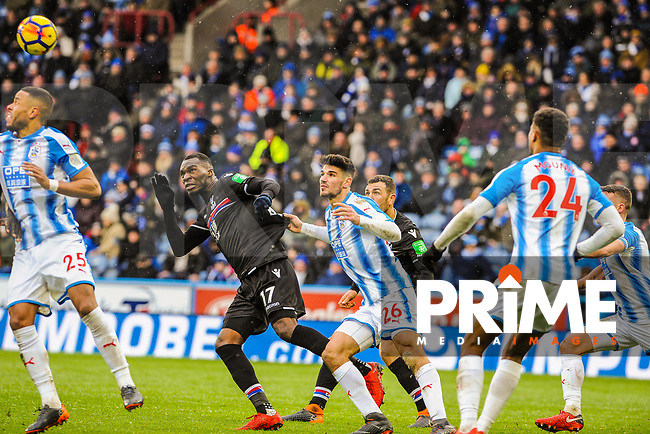 Crystal Palace's forward Christian Benteke (17) leans back to head over under pressure from Huddersfield Town's defender Christopher Schindler (26) during the EPL - Premier League match between Huddersfield Town and Crystal Palace at the John Smith's Stadium, Huddersfield, England on 17 March 2018. Photo by Stephen Buckley / PRiME Media Images.