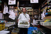 Portraits of people who work at Tsukiji fish market, Tokyo, Japan, January 17, 2007. The Tokyo Metropolitan Central Wholesale Market, better known as Tsukiji market, is the largest fish market in the world. Tsukiji is both a popular tourist attraction and a Mecca of Japanese food culture.