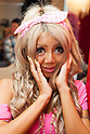 Harutamu, a member of staff, poses for a picture at the Ganguro Cafe &amp; Bar in the Shibuya shopping area on September 4, 2015. <br /> <br /> Ganguro is an alternative Japanese fashion trend which started in the mid-1990s where young women, rebelling against the traditional idea of Japanese beauty, wore colorful make-up and clothes and had dark-skin.<br /> <br /> 10 Ganguro fashion girls work in the new bar, which offers original Ganguro Balls (fried takoyaki style sausage balls in black squid ink batter) on its menu. Ganguro Caf&eacute; &amp; Bar also offers special services such as Ganguro make-up and the chance to take purikura (photo booth pictures) with staff and to look like a Ganguro girl walking around the Shibuya streets.<br /> <br /> The bar is popular with both Japanese and foreigners and has menus translated in English. (Photo by Rodrigo Reyes Marin/AFLO)