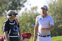 Marcel Siem (GER) and caddy Bo at the 13th green during Thursday's Round 1 of the 2016 Portugal Masters held at the Oceanico Victoria Golf Course, Vilamoura, Algarve, Portugal. 19th October 2016.<br /> Picture: Eoin Clarke | Golffile<br /> <br /> <br /> All photos usage must carry mandatory copyright credit (&copy; Golffile | Eoin Clarke)