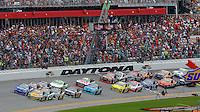 Green flag waves to start the Coke Zero 400, Daytona International Speedway, Daytona Beach , Florida, July 2014.  (Photo by Brian Cleary/www.bcpix.com)